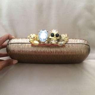 Ring Clutch Skull