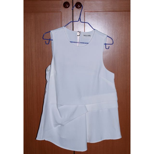 This is April Sleeveless Top