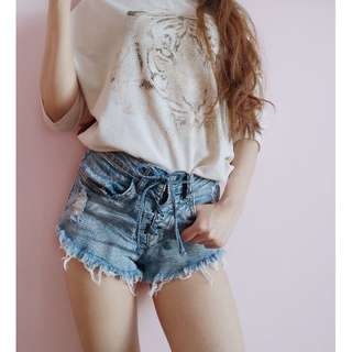 High waisted distressed denim shorts with cute lace up front