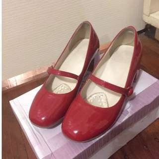 Red mary jane style low heeled shoes