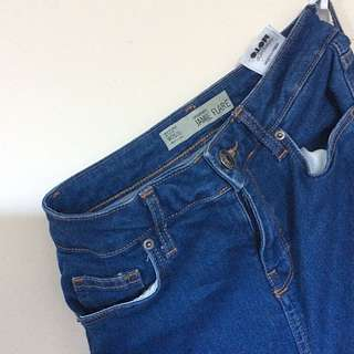 Topshop Jamie Flare Ripped Hem High waisted 70's Jeans