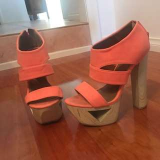 Women's Qupid wood cutout tall block heels in orange. Fits size 6 and 6.5.