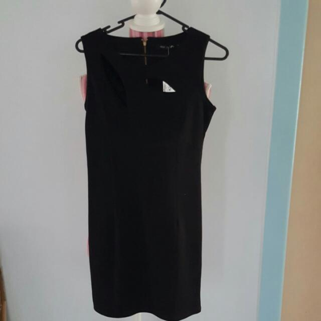 Brand new black dress (size 8) with gold zipper and cut outs