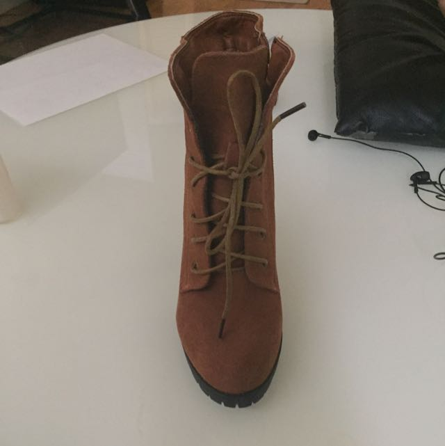 Brown Short Boots. Size 7. Worn Only Once!  I Have Too Many Brown Boots And I'm Deciding To Sell This One.. It's Very Comfortable And Looks Cute With Jeans.