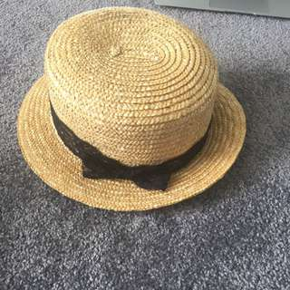straw hat with lacey ribbon