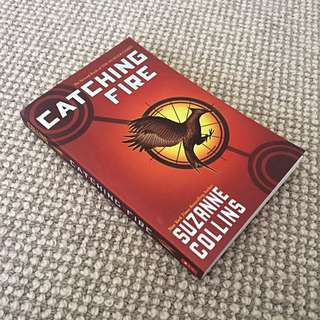 Brand new copy of Catching Fire by Suzanne Collins.