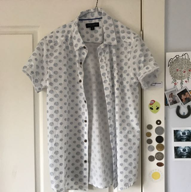 White Shirt With Blue Shell Patterns