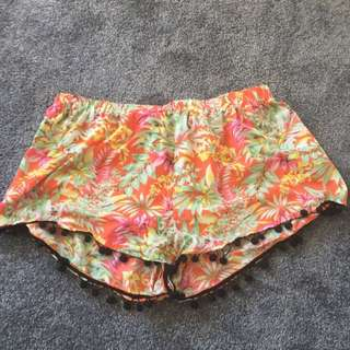 orange flowery shorts
