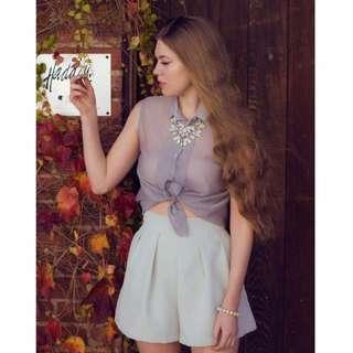 Translucent grey sleeveless shirt