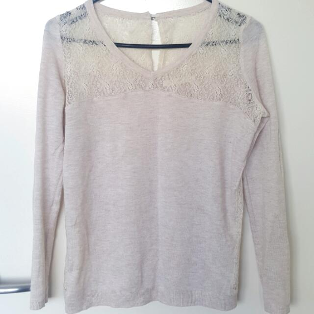 Pale pink jumper. Lace on the shoulder and on the sides.