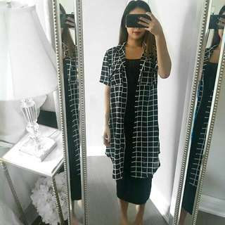 Woman's Long Grid Patterned Shirt