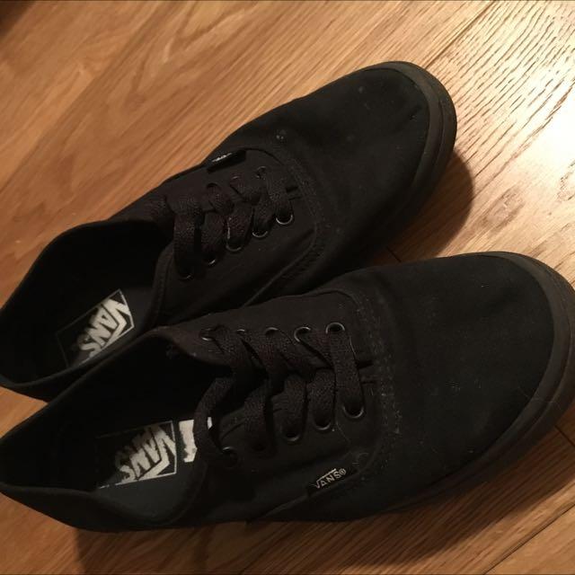 Black vans lace up low top sneakers