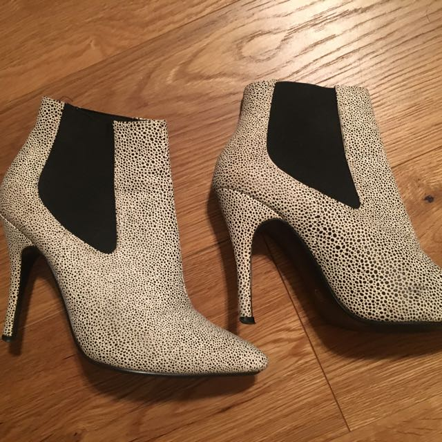 Women's pair of white and black booties