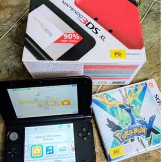 Nintendo 3DS XL Red/Black + Pokemon X For Sale