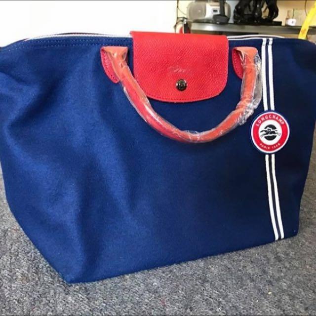 Authentic Longchamp Cocarde