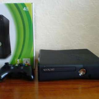 Xbox 360 with a bunch of games, 2 controls and headset