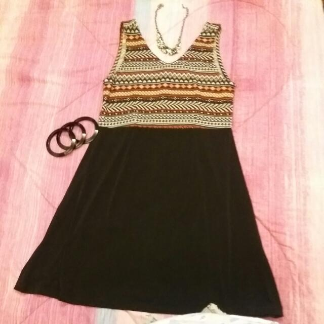 folded and hung tribal design dress