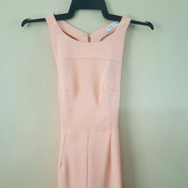 Brand new pastel orange dress with mid split