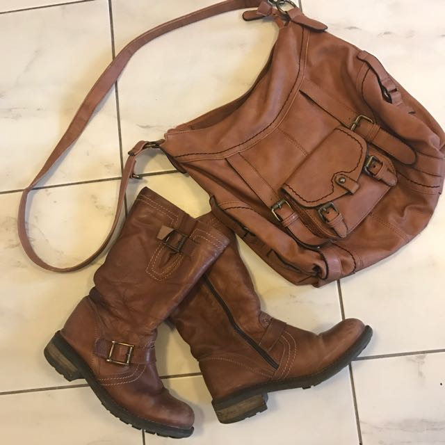 Suede winter boots with matching purse.