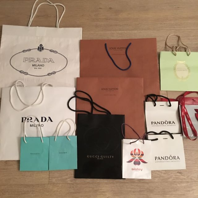 PRADA LOUIS VUITTON PANDORA CHANEL SISLEY GUCCI LADUREE BAGS