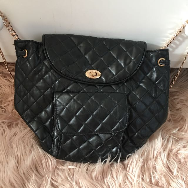 Black Backpack With Gold Detailing