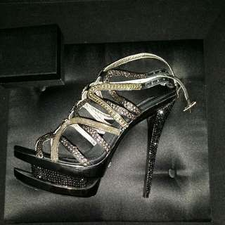 ZIGIny Blacklabel Gold And Black Strappy Heels Covered In Swarovski Crystals