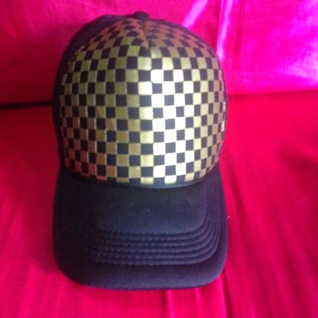 gold and black cap