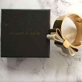Charles And Keith Gold & White Marble Bow Bangle