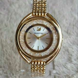 SWAROVSKI CRYSTALLINE GOLD ON BRACELET FASHION LADIES WATCH