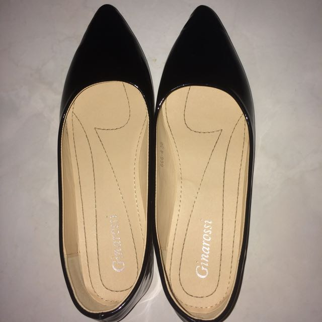 black pointy flat shoes by ginarossi