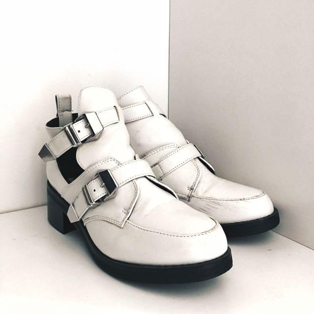 White Zu Boots.