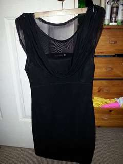 Black dress with sheer top and drape