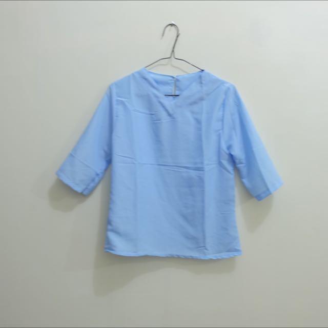 pastel blue top