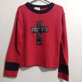 red cross sweater