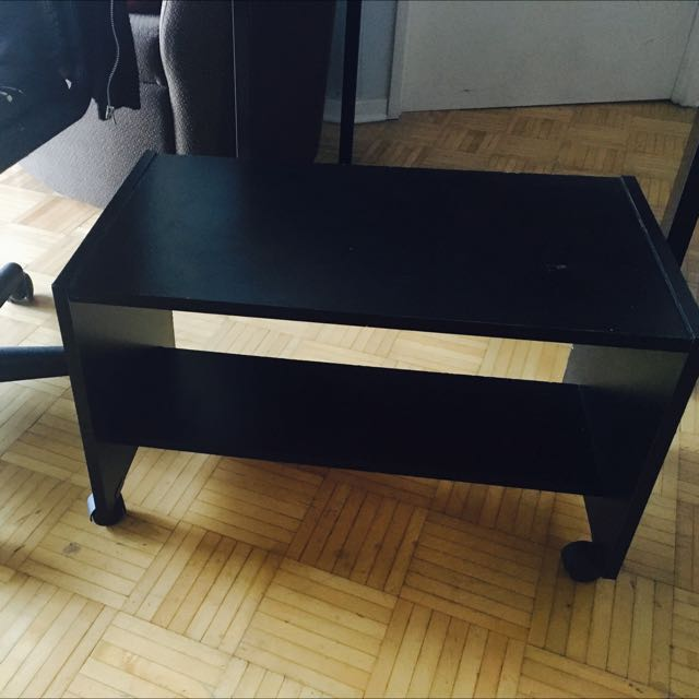 Rectangular black wooden rolling table