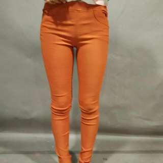 女橘色長褲
