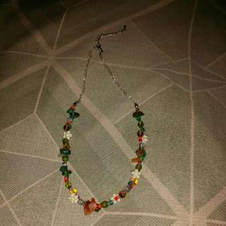 A Necklace With Various Things On It