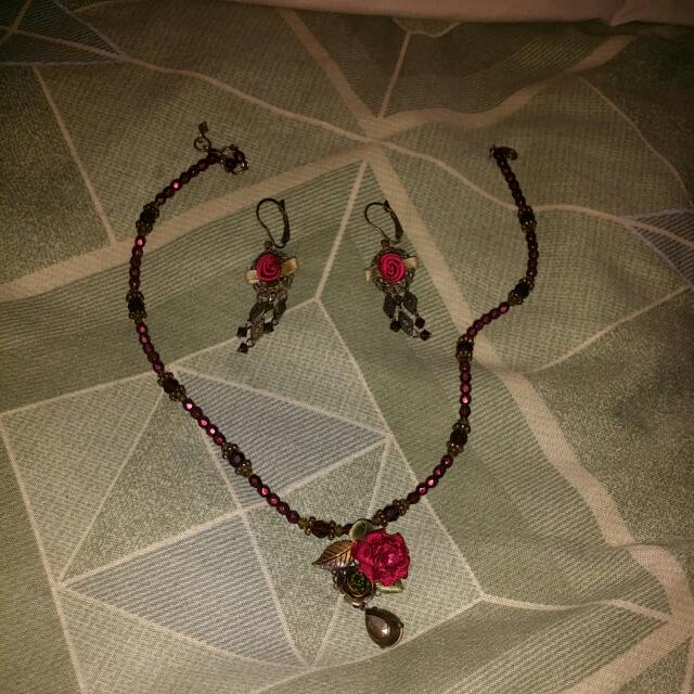 A Rose Necklace With Matching Earrings
