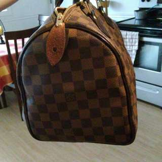 AAA Louis Vuitton Purse. Very Good Condition..