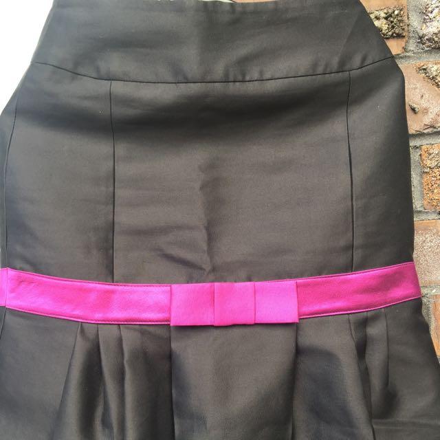 Adrienne Winkelmann, Elegant Purple Bow Skirt