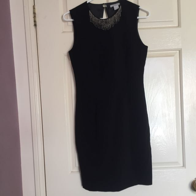Black cocktail length dress with bead neckline