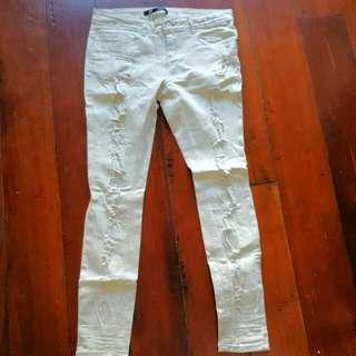Torn Cream Jeans