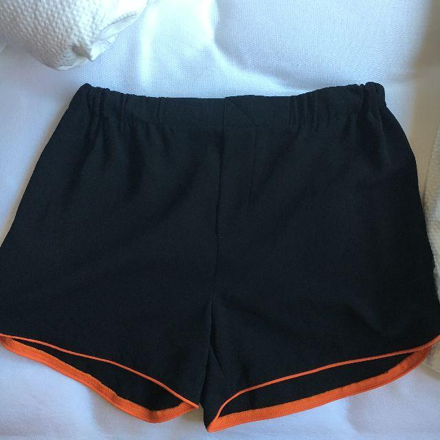 Black Shorts with Orange Trimming