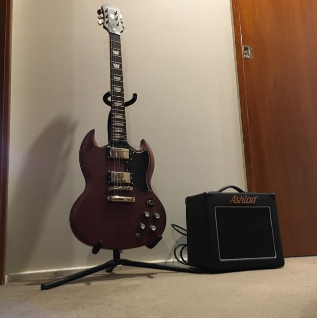 Electric Guitar, Amplifier And Stand