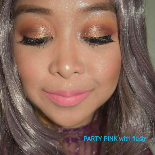 "matte liquid lipstick in the shade ""Party Pink"""