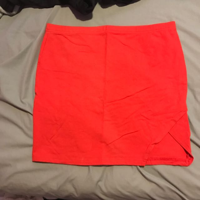 red skirt with a corner cut out