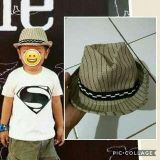 topi koboi anak