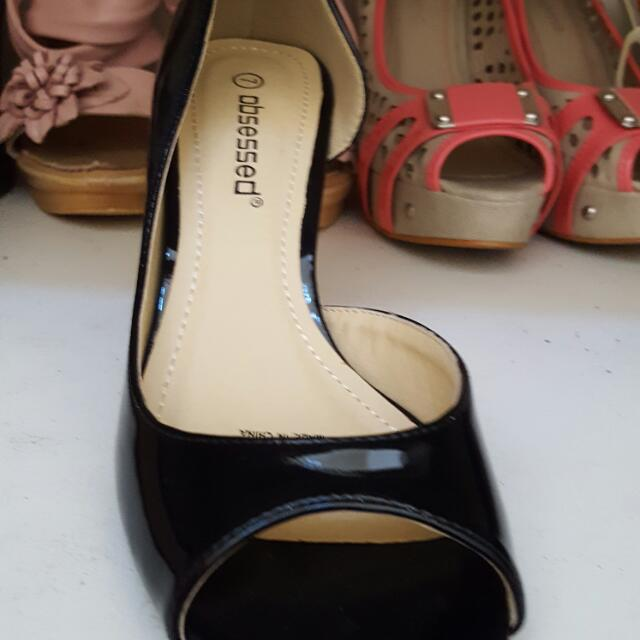 Ladies black paten heels