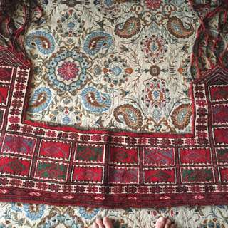 Antique handmade rug around the fireplace negotiable