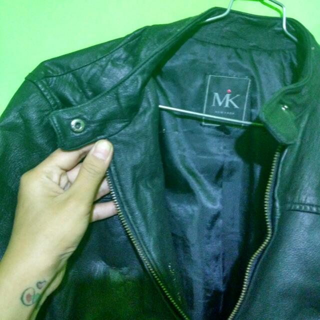 jaket kulit asli merk MK newyork .